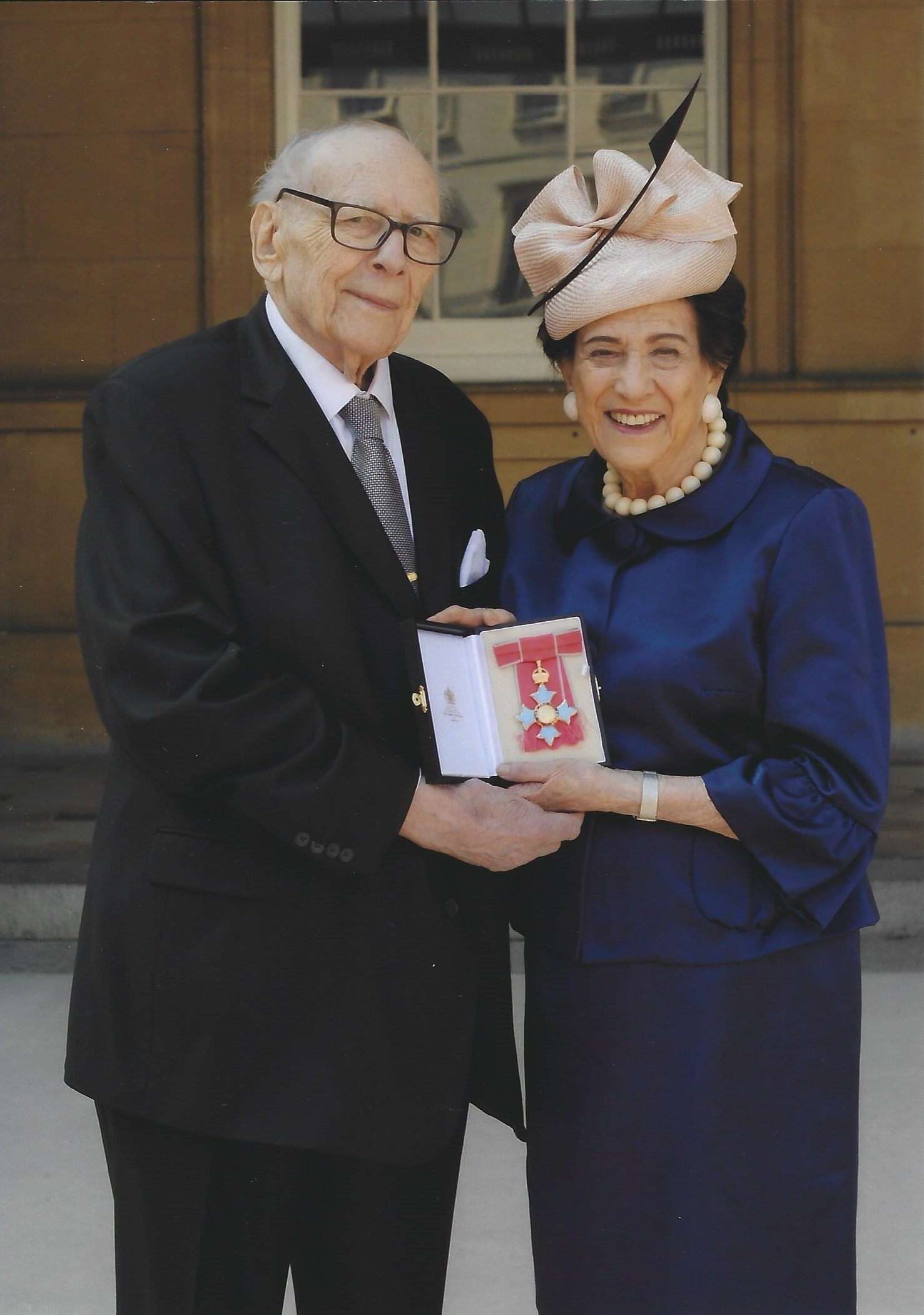 Lilian and Victor Hochhauser after the Investiture
